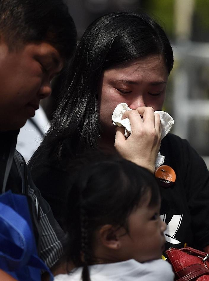 Relatives of passengers onboard the missing Malaysia Airlines flight MH370, attend a remembrance event in Kuala Lumpur on March 8, 2015 (AFP Photo/Manan Vatsyayana)