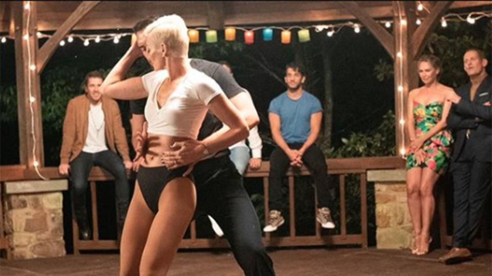 Jess Rowe (front) and Firass Dirani (blue shirt) on set of The Real Dirty Dancing in 2019.