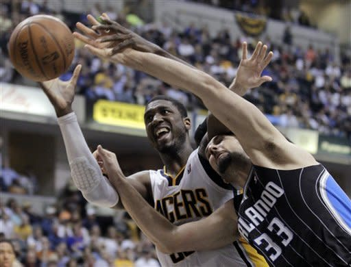 Orlando Magic forward Ryan Anderson, right, and Indiana Pacers center Roy Hibbert go for a rebound during the second half of Game 5 of an NBA basketball first-round playoff series, in Indianapolis on Tuesday, May 8, 2012. The Pacers defeated the Magic 105-87 to win the series 4-1. (AP Photo/Michael Conroy)