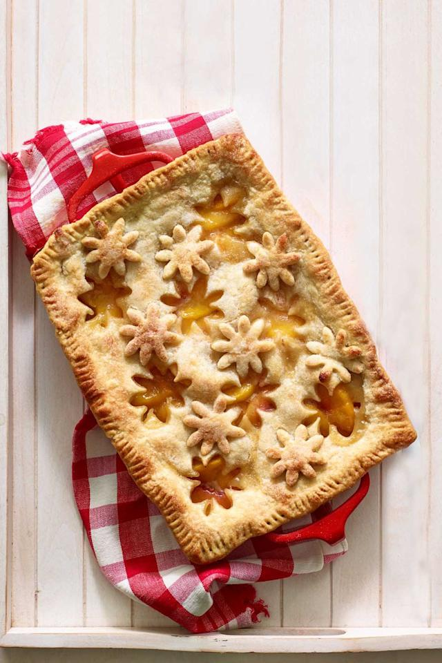"""<p>Create the perfect peach cobbler for your next summer party or <a rel=""""nofollow"""" href=""""https://www.womansday.com/food-recipes/food-drinks/g2196/picnic-food-ideas/"""">date night picnic</a>. </p><p><strong><a rel=""""nofollow"""" href=""""https://www.womansday.com/food-recipes/food-drinks/recipes/a12903/texas-peach-cobbler-recipe-wdy0814/"""">Get the recipe.</a></strong></p>"""