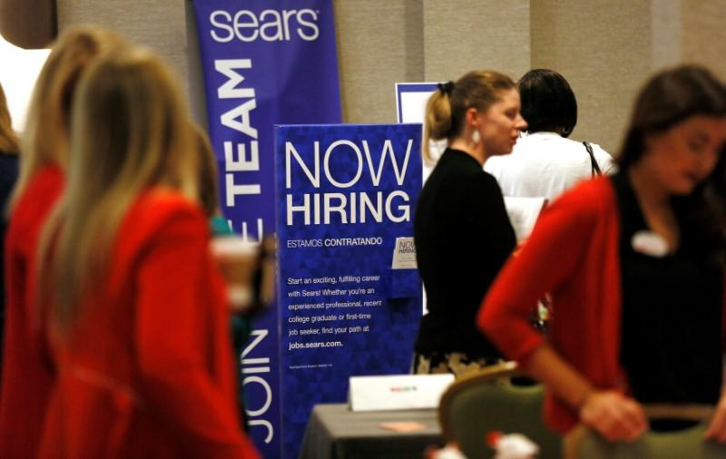 Recruiters and job seekers are seen at a job fair in Golden