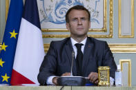 French President Emmanuel Macron attends a Climate Summit video conference, at the Elysee Palace, in Paris, France, Thursday, April, 22, 2021. (Ian Langsdon/ Pool photo via AP)