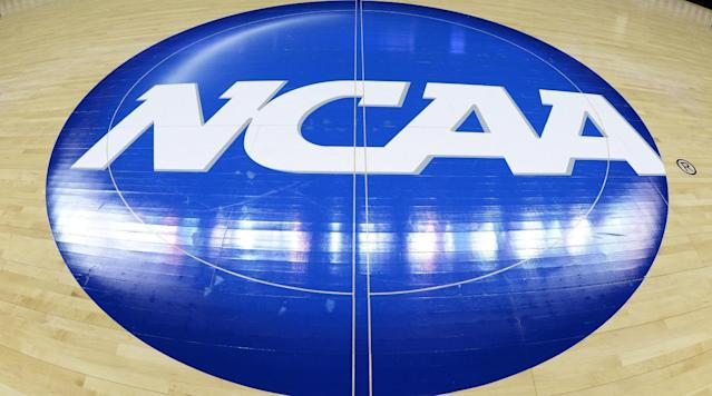 <p>NCAA stands for National Collegiate Athletic Association.</p><p>The non-profit organization is made up of 1,117 schools that are split into 40 conferences. among three divisions. Division II schools do not have as many athletic scholarships to offer as Division I schools, and Division III schools do not award any athletic scholarships.</p><p>There are 24 sports played by NCAA teams. Baseball, basketball (men's and women's), beach volleyball, bowling, cross country (men's and women's), fencing, field hockey, football, golf (men's and women's), gymnastics (men's and women's), ice hockey (men's and women's), lacrosse (men's and women's), rifle, rowing, skiing, soccer (men's and women's), softball, swimming and diving (men's and women's), tennis (men's and women's), indoor track (men's and women's), outdoor track (men's and women's), volleyball (men's and women's), water polo (men's and women's) and wrestling are the sports the NCAA offers.</p><p>The organization was founded in 1906 and its headquarters is in Indianapolis.</p><p>There are 351 teams in Division I men's basketball, 349 Division I women's basketball teams and 252 Division I football teams (129 in Division I-A and 123 in Division I-AA).</p>