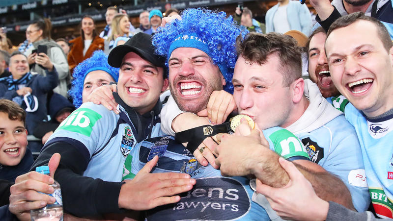 James Tedesco of the Blues poses with fans after winning game three of the 2019 State of Origin series between the New South Wales Blues and the Queensland Maroons at ANZ Stadium on July 10, 2019 in Sydney, Australia. (Photo by Cameron Spencer/Getty Images)