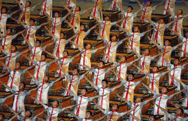 Drummers perform during the opening ceremony for the Beijing 2008 Olympics in Beijing, Friday, Aug. 8, 2008. (AP Photo/Luca Bruno)