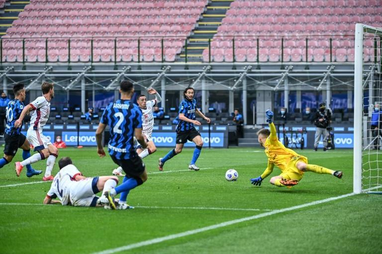 Inter Milan's Achraf Hakimi centres the ball for Matteo Darmian to score at the San Siro