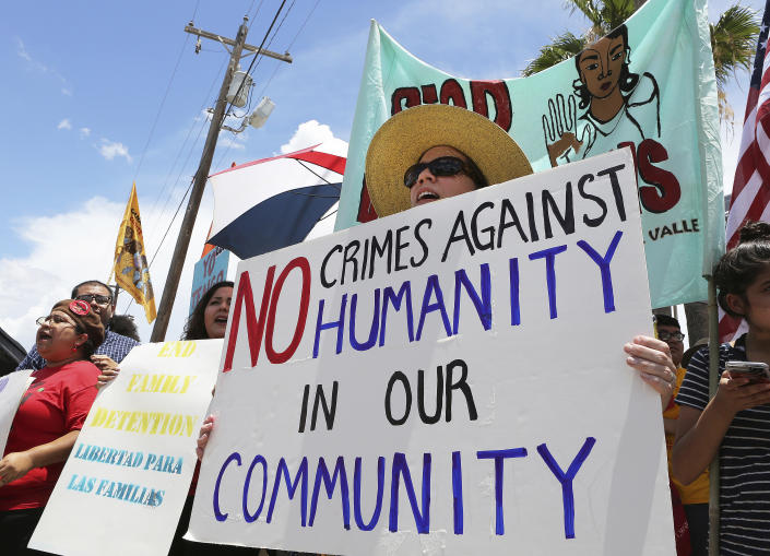 <p>Stefanie Herweck stands with other protesters in front of the U.S. Customs and Border Protection's Rio Grande Valley Sector's Centralized Processing Center on June 17, 2018, in McAllen, Texas. (Photo: Joel Martinez/The Monitor via AP) </p>