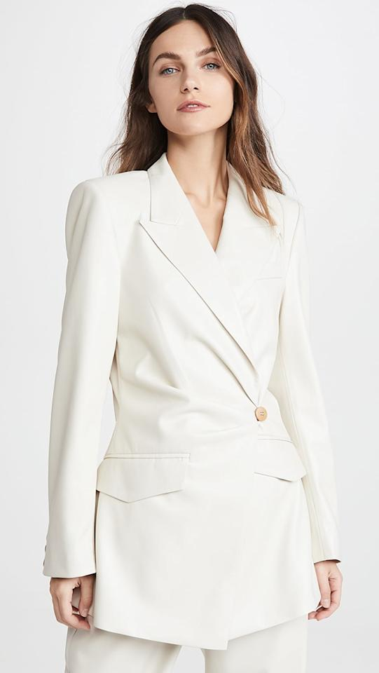"<p>This <a href=""https://www.popsugar.com/buy/Nanushka-Blair-Blazer-556880?p_name=Nanushka%20Blair%20Blazer&retailer=shopbop.com&pid=556880&price=695&evar1=fab%3Aus&evar9=47308834&evar98=https%3A%2F%2Fwww.popsugar.com%2Ffashion%2Fphoto-gallery%2F47308834%2Fimage%2F47309067%2FNanushka-Blair-Blazer&list1=shopping%2Cspring%2Cspring%20fashion&prop13=mobile&pdata=1"" rel=""nofollow"" data-shoppable-link=""1"" target=""_blank"" class=""ga-track"" data-ga-category=""Related"" data-ga-label=""https://www.shopbop.com/blair-blazer-nanushka/vp/v=1/1512984913.htm?folderID=13198&amp;fm=other-shopbysize-viewall&amp;os=false&amp;colorId=83629&amp;ref=SB_PLP_NB_8"" data-ga-action=""In-Line Links"">Nanushka Blair Blazer</a> ($695) is insanely chic.</p>"