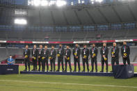 New Zealand players pose on the podium with their silver medals in men's rugby sevens at the 2020 Summer Olympics, Wednesday, July 28, 2021 in Tokyo, Japan. (AP Photo/Shuji Kajiyama)