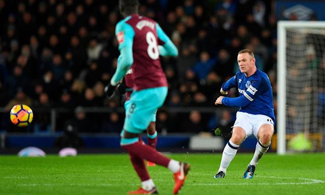 Wayne Rooney lets fly from inside Everton's own half to score against West Ham at Goodison Park.