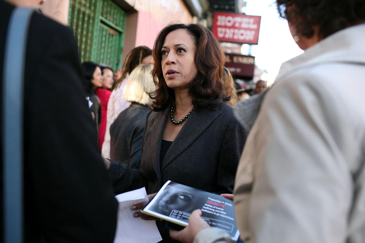 <p>In October 2008, Kamala accessorized a charcoal suit with shimmering black pearls for a press conference in California, where she's from.</p>