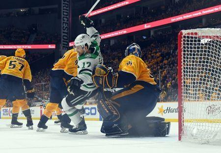 Apr 20, 2019; Nashville, TN, USA; Dallas Stars center Andrew Cogliano (17) is knocked down in front of Nashville Predators goaltender Pekka Rinne (35) during the first period in game five of the first round of the 2019 Stanley Cup Playoffs at Bridgestone Arena. Mandatory Credit: Christopher Hanewinckel-USA TODAY Sports