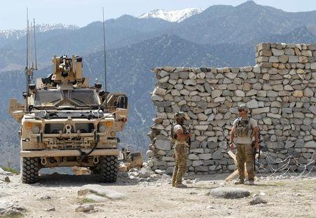 U.S. soldiers stand guard near the site of a U.S. bombing in the Achin district of Nangarhar province in eastern Afghanistan April 15, 2017. REUTERS/Parwiz