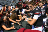 South Carolina quarterback Ryan Hilinski celebrates with fans as he leaves the field after an NCAA college football game against Charleston Southern, Saturday, Sept. 7, 2019, in Columbia, S.C. South Carolina won 72-10. (AP Photo/John Amis)
