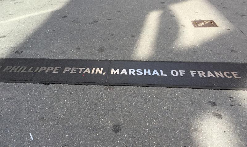 The sidewalk along Broadway shows the plaque honoring Henri Philippe Pétain on August 17, 2017 in New York