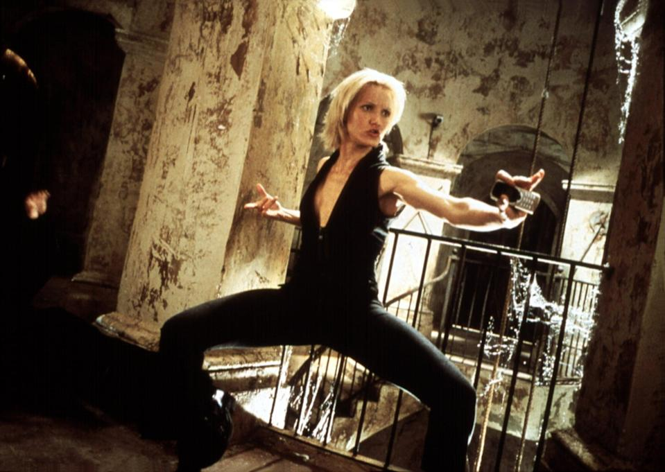 <p>Cameron wore this V-neck jumpsuit while kicking some butt.</p>