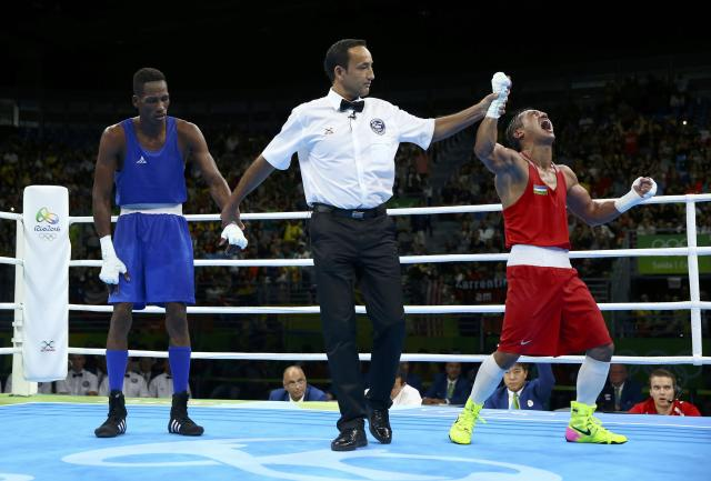 2016 Rio Olympics - Boxing - Final - Men's Light Welter (64kg) Final Bout 272 - Riocentro - Pavilion 6 - Rio de Janeiro, Brazil - 21/08/2016. Fazliddin Gaibnazarov (UZB) of Uzbekistan reacts after winning his bout against Collazo Sotomayor (AZE) of Azerbaijan. REUTERS/Peter Cziborra FOR EDITORIAL USE ONLY. NOT FOR SALE FOR MARKETING OR ADVERTISING CAMPAIGNS.