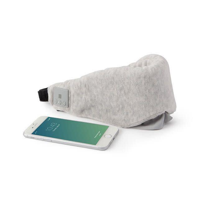 """For the sleepy friend who still has to travel for the holidays, this mask might help them get some shut eye. It's comfy, cordless and they'll be able to listen to any lullaby on the go.&nbsp;<strong><a href=""""https://fave.co/2sNjQ9H"""" rel=""""nofollow noopener"""" target=""""_blank"""" data-ylk=""""slk:Get it for $40 at Uncommon Goods"""" class=""""link rapid-noclick-resp"""">Get it for $40 at Uncommon Goods</a></strong>.&nbsp;"""