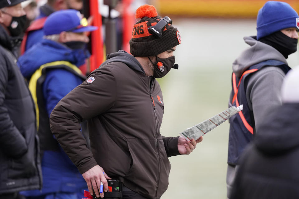 Cleveland Browns head coach Kevin Stefanski watches from the bench during the first half of an NFL divisional round football game against the Kansas City Chiefs, Sunday, Jan. 17, 2021, in Kansas City. (AP Photo/Charlie Riedel)