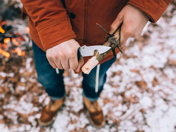 cutting wood with pocket knife