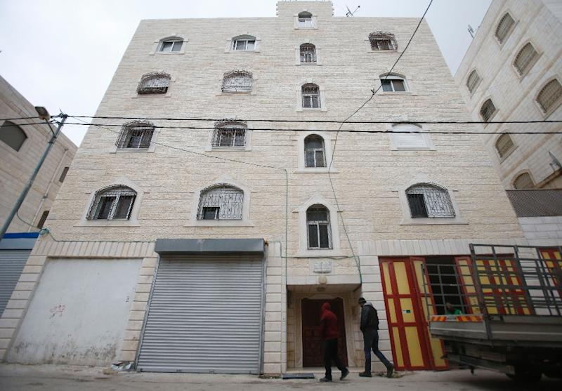 A picture taken on February 10, 2019 shows the building of Arafat Irfaya's house, a Palestinian suspected of killing a young Israeli woman, in the flashpoint city of Hebron in the south of the occupied West Bank (AFP Photo/HAZEM BADER)