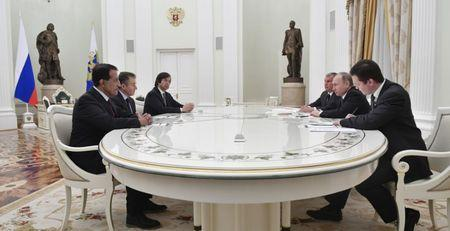 Russian President Putin and Rosneft CEO Sechin meet with participants of Rosneft privatisation deal at Kremlin in Moscow