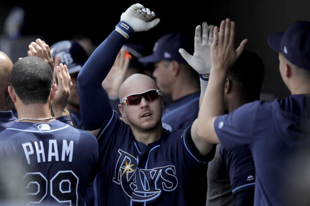 Tampa Bay Rays' Michael Brosseau is greeted in the dugout after hitting a two-run home run off Baltimore Orioles starting pitcher Thomas Eshelman during the sixth inning of a baseball game, Sunday, July 14, 2019, in Baltimore. (AP Photo/Julio Cortez)