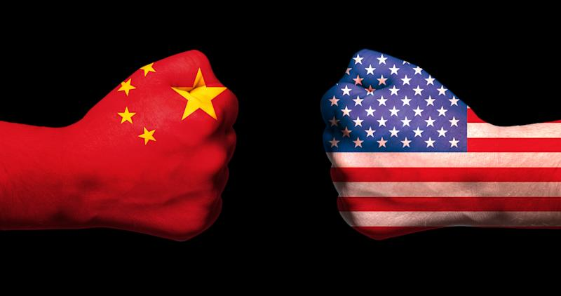 Two fists emblazoned with U.S. and Chinese flags meet.