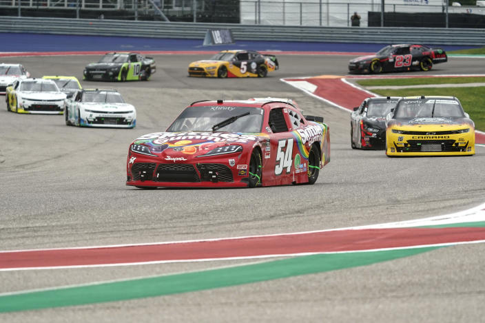 Kyle Busch (54) leads the field into Turn 13 during the NASCAR Xfinity Series auto race at the Circuit of the Americas in Austin, Texas, Saturday, May 22, 2021. (AP Photo/Chuck Burton)