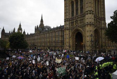 Demonstrators gather outside the Houses of Parliament during a protest aimed at showing London's solidarity with the European Union following the recent EU referendum, in central London