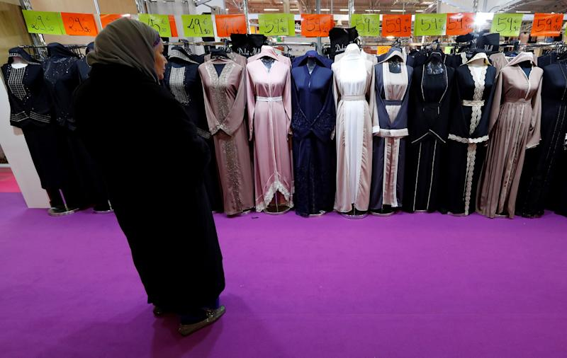A visitor looks at women's clothes during a meeting organized by the Union of Islamic Organizations of France at Le Bourget, near Paris, in March 2018.  (Photo: Gonzalo Fuentes / Reuters)