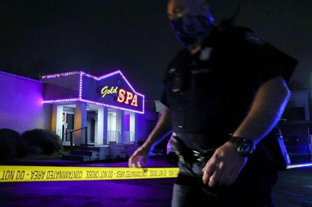 PHOTO: City of Atlanta Police Officer Davis works at the scene outside of Gold Spa after deadly shootings in the Atlanta area, in Atlanta, March 16, 2021. (Christopher Aluka Berry/Reuters)