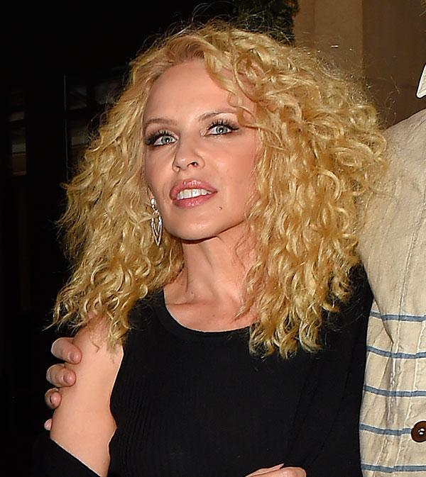 """The Aussie songstress just went back to her roots, literally! Rocking her natural curls which she had when we fell in love with her all those years ago as Charlene on <i>Neighbours</i>. Kylie teased the look on Instagram, writing """"Some things never change #curls #backtobasics"""" before stepping out in London for a night on the town to officially show off her new look."""
