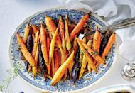 """<p><strong>Recipe: <a href=""""https://www.southernliving.com/recipes/honey-glazed-spiced-carrots-side-dish"""" rel=""""nofollow noopener"""" target=""""_blank"""" data-ylk=""""slk:Honey-Glazed Spiced Carrots"""" class=""""link rapid-noclick-resp"""">Honey-Glazed Spiced Carrots</a></strong></p> <p>The naturally sweet flavor that is released during the cooking process combined with the honey glaze will make carrots the most popular side dish this year. </p>"""