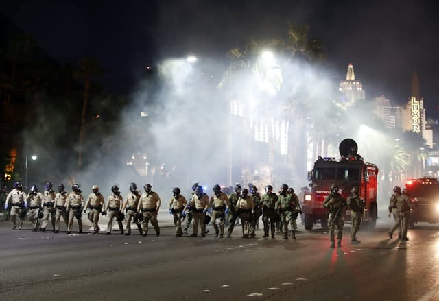 Police disperse protesters with gas on the Las Vegas Strip