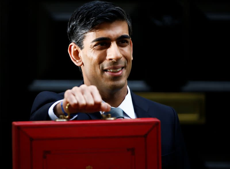 Britain's Chancellor of the Exchequer Rishi Sunak poses outside his office in Downing Street in London