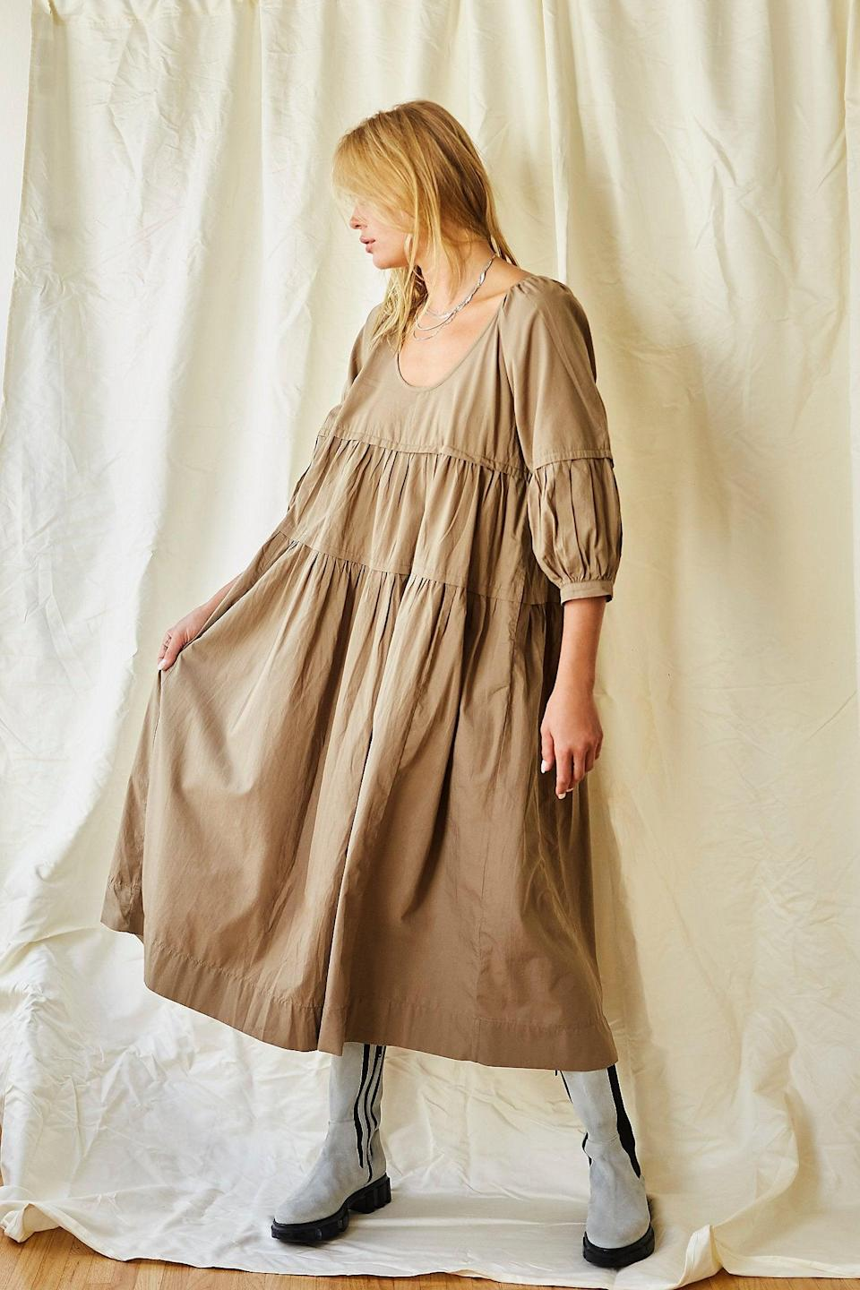 """<h2>Free People Syd Poplin Midi Dress</h2><br>Do your tastes tend towards the loose, the layered, and the ... dare we say ... <em>boho</em>? Legions of love children flock to Free People for exactly that, and the retailer is replete with under-$100 frocks that flow, waft, and billow. Our fall pick — a tented poplin number with accommodating sleeves — is no exception.<br><br><strong>Endless Summer</strong> Syd Poplin Midi Dress, $, available at <a href=""""https://go.skimresources.com/?id=30283X879131&url=https%3A%2F%2Fwww.freepeople.com%2Fshop%2Fsyd-poplin-midi-dress%2F%3Fcategory%3Ddresses%26color%3D030%26type%3DREGULAR%26quantity%3D1"""" rel=""""nofollow noopener"""" target=""""_blank"""" data-ylk=""""slk:Free People"""" class=""""link rapid-noclick-resp"""">Free People</a>"""