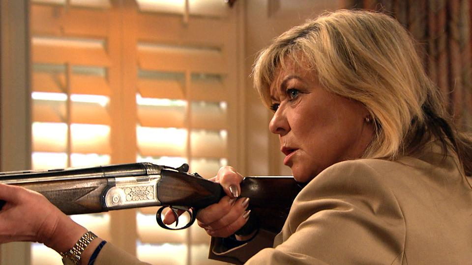 FROM ITV  STRICT EMBARGO  Print media - No Use Before Tuesday 18th May 2021 Online Media - No Use Before 0700hrs Tuesday 18th May  2021  Emmerdale - Ep 9058  Thursday 27th May 2021 - 1st Ep  As she sits inside Home Farm clutching her shotgun, Kim TateÕs [CLAIRE KING] shocked to see a figure enter the house on the CCTV system. A terrified Kim fires her gun at the intruder...   Picture contact David.crook@itv.com   This photograph is (C) ITV Plc and can only be reproduced for editorial purposes directly in connection with the programme or event mentioned above, or ITV plc. Once made available by ITV plc Picture Desk, this photograph can be reproduced once only up until the transmission [TX] date and no reproduction fee will be charged. Any subsequent usage may incur a fee. This photograph must not be manipulated [excluding basic cropping] in a manner which alters the visual appearance of the person photographed deemed detrimental or inappropriate by ITV plc Picture Desk. This photograph must not be syndicated to any other company, publication or website, or permanently archived, without the express written permission of ITV Picture Desk. Full Terms and conditions are available on  www.itv.com/presscentre/itvpictures/terms