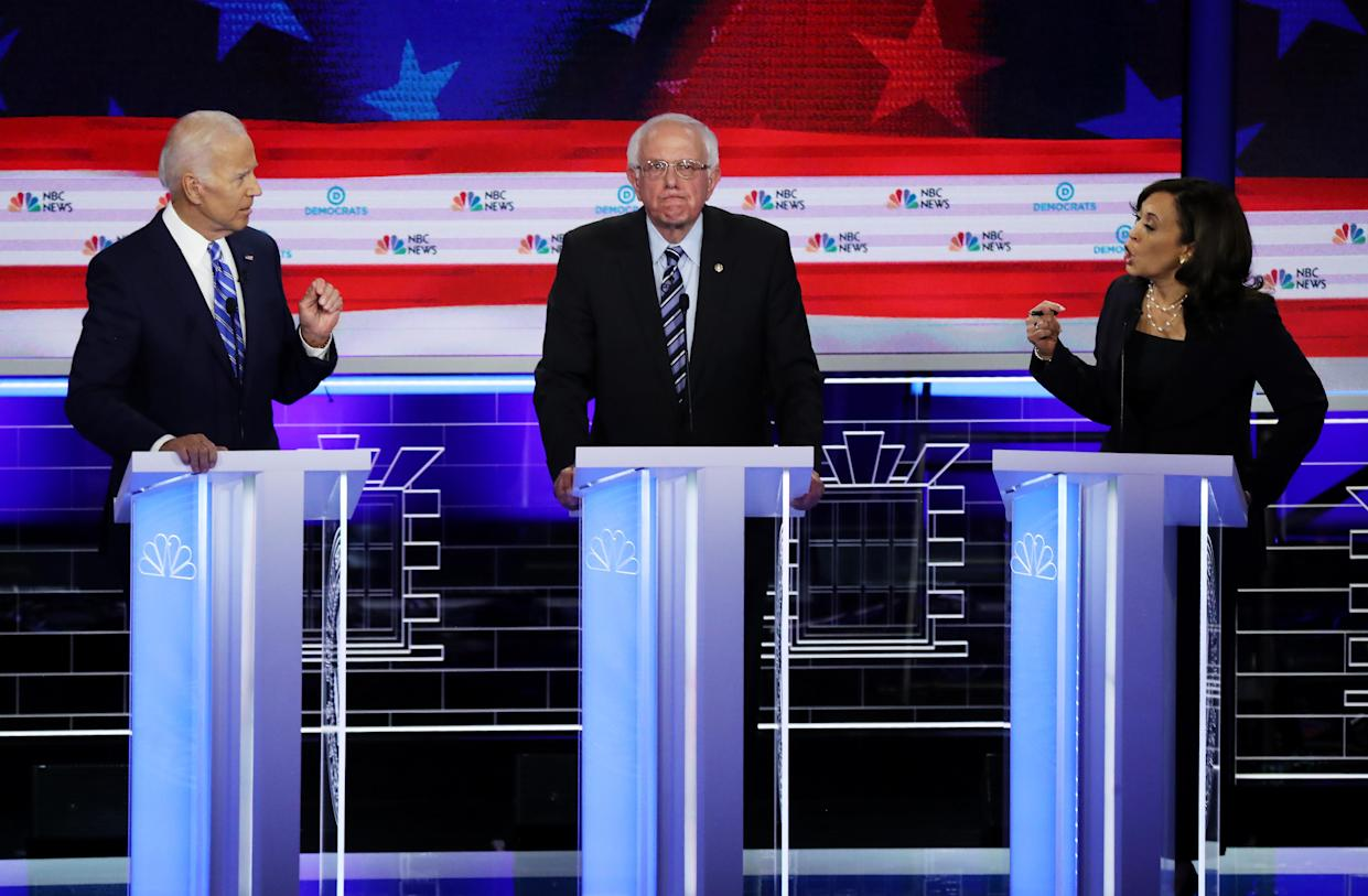 Sen. Kamala Harris and former Vice President Joe Biden speak as Sen. Bernie Sanders looks on during the Democratic presidential debate on Thursday night. (Photo: Drew Angerer/Getty Images)