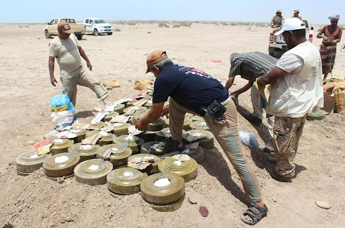 Yemeni security forces inspect unexploded ordnance confiscated from Al-Qaeda militants in the Lahj province (AFP Photo/Saleh Al-Obeidi)