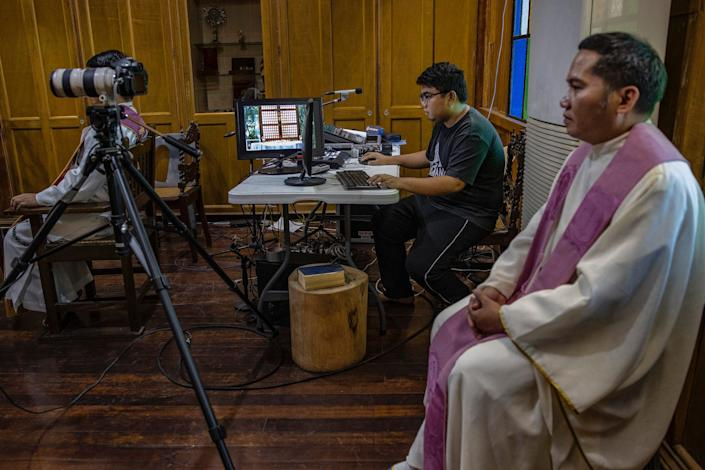A Catholic priest prepares to hold mass over internet livestream at a chapel as authorities ban religious gatherings amid the threat of the coronavirus on March 22, 2020 in Manila, Philippines.