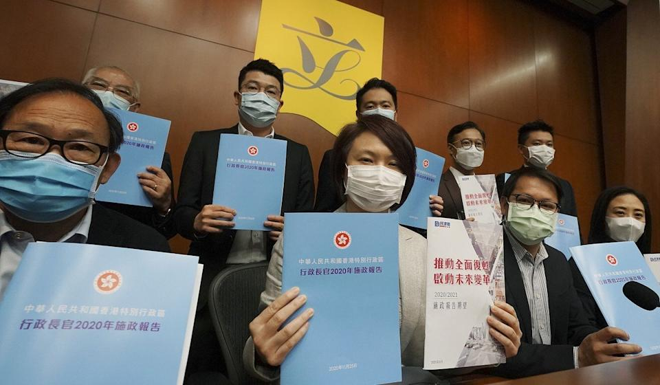 Lawmaker Starry Lee (second left) and other DAB lawmakers with copies of Carrie Lam's policy address last November. Photo: Felix Wong