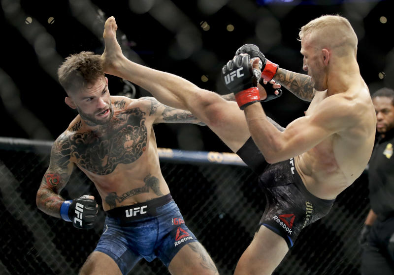 T.J. Dillashaw right kicks Cody Garbrandt during their UFC title bantamweight mixed martial arts bout at UFC 227 in Los Angeles Saturday Aug. 4 2018