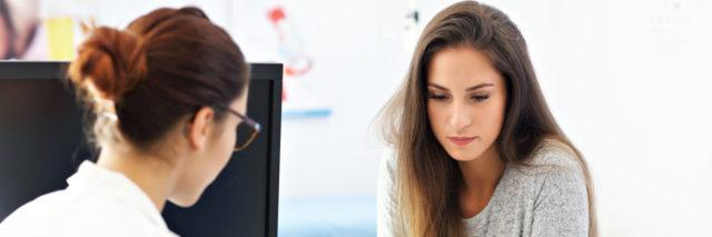 Picture of adult woman having a visit at female doctor's office