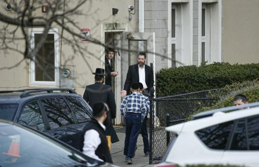 Members of the Jewish community leave a synagogue next to the home of rabbi, Chaim Rottenberg, in Monsey, New York on December 29, 2019 after a machete attack that took place the previous day