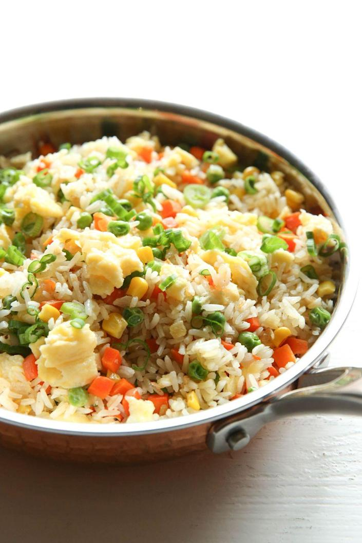 "<p>This is a true crowd pleaser.</p><p>Get the recipe from <a href=""https://www.delish.com/cooking/recipe-ideas/recipes/a51448/easy-fried-rice-recipe/"" rel=""nofollow noopener"" target=""_blank"" data-ylk=""slk:Delish"" class=""link rapid-noclick-resp"">Delish</a>.</p>"