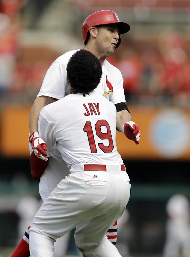St. Louis Cardinals' Peter Bourjos is congratulated by teammate Jon Jay (19) after hitting a walk-off single to score Yadier Molina during the ninth inning of a baseball game against the Pittsburgh Pirates Wednesday, Sept. 3, 2014, in St. Louis. The Cardinals won 1-0. (AP Photo/Jeff Roberson)