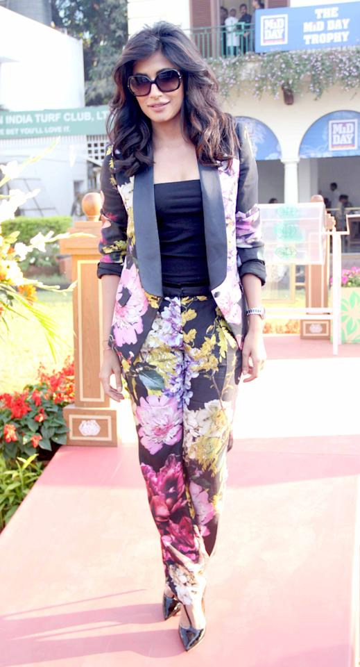Chitrangada Singh oozes of sex appeal! With looks to kill, it seems like she can get away with anything. Check her out here in a printed floral suit. How many people you know can carry this off?