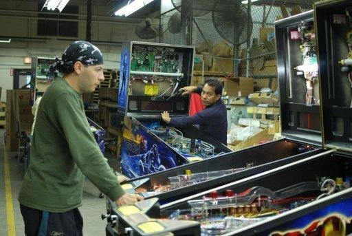 Workers at Stern Pinball assemble Rolling Stones pinball machines in Chicago on August 15, 2011. Stern is the only remaining pinball maker in the world and the company's founder - along with a core group of devoted players - is determined to the keep the game alive