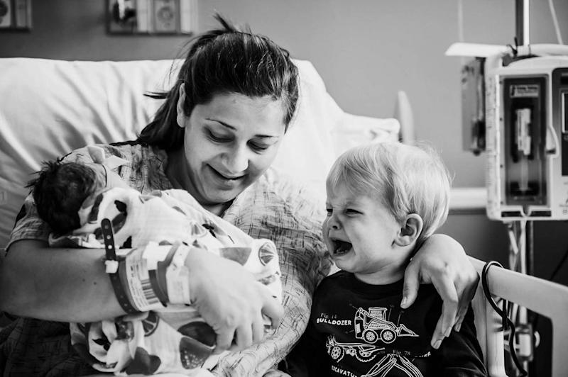 22-month-old Jackson couldn't contain his tears when meeting his baby sister for the first time (Jordan Burch Photography)